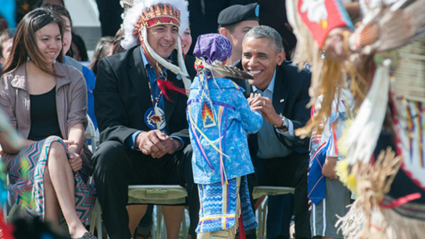 President Obama and SRST Chair Dave Archambault II greet a young dancer during a June 2014 visit